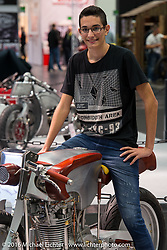 The son of Francesco Bella represented his builder father with their North Coast Customs (Santa Lucia del Mela, Italy) built stylish bare metal and wood entry that also sports a North Coast Custom one-of-a-kind 521cc single cylinder engine that they made themselves, at the Intermot Motorcycle Trade Fair. Cologne, Germany. Wednesday October 5, 2016. Photography ©2016 Michael Lichter.