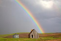 Rainbow over old homestead  in Swan Valley Idaho