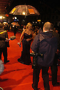 Charlise Theron. arrive at the 2006 BAFTA Awards at the Leicester Square Odeon Cinema in London. 19 February 2006.  -DO NOT ARCHIVE-© Copyright Photograph by Dafydd Jones 66 Stockwell Park Rd. London SW9 0DA Tel 020 7733 0108 www.dafjones.com