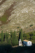 Church Saint Nikolaos Petra cypresses, mountain village of Old Perithia and Mount Pandokrator, Corfu, Greece