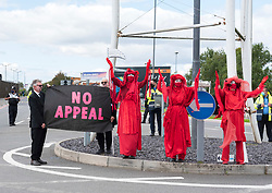 "© Licensed to London News Pictures;29/08/2020; Bristol Airport, Lulsgate Bottom, UK. ""the Red People"" take part in a Common Ground with Extinction Rebellion protest at Bristol Airport against plans to expand the airport and against the airport's decision to appeal against a refusal by North Somerset Council over the expansion plans. This is on the second day of a bank holiday weekend of protest across the UK by Extinction Rebellion. XR are protesting in Bristol and other cities in the UK against climate change, leading up to a protest in London starting on 01 September. XR say that despite clear scientific evidence of the deadly climate and ecological emergency, the UK government are refusing to take the urgent action needed to avoid mass extinction. XR say we need politicians to support the Climate and Ecological Emergency Bill. During the coronavirus covid-19 pandemic, climate change is being forgotten but it is still an emergency that is happening, the elephant in the room. Photo credit: Simon Chapman/LNP."
