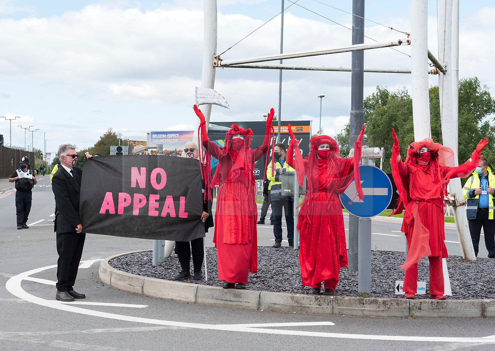 """© Licensed to London News Pictures;29/08/2020; Bristol Airport, Lulsgate Bottom, UK. """"the Red People"""" take part in a Common Ground with Extinction Rebellion protest at Bristol Airport against plans to expand the airport and against the airport's decision to appeal against a refusal by North Somerset Council over the expansion plans. This is on the second day of a bank holiday weekend of protest across the UK by Extinction Rebellion. XR are protesting in Bristol and other cities in the UK against climate change, leading up to a protest in London starting on 01 September. XR say that despite clear scientific evidence of the deadly climate and ecological emergency, the UK government are refusing to take the urgent action needed to avoid mass extinction. XR say we need politicians to support the Climate and Ecological Emergency Bill. During the coronavirus covid-19 pandemic, climate change is being forgotten but it is still an emergency that is happening, the elephant in the room. Photo credit: Simon Chapman/LNP."""