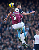 Photo: Daniel Hambury.<br />Tottenham Hotspur v West Ham Utd. The Barclays Premiership. 20/11/2005.<br />Spurs' Michael Carrick beats West Ham's Teddy Sheringham in the air.