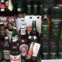 Europe, Ireland, Westport. Whisky selection displayed in storefront window.