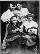 The Curie family. Left to right standing, Jacques, Pierre (1859-1908) French chemist, Seated, Mme Curie and Dr Eugene Curie