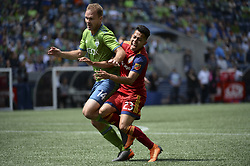 May 26, 2018 - Seattle, Washington, U.S - MLS Soccer 2018: RSL's SEBASTIAN SAUCEDO (23) runs into Seattle defender CHAD MARSHALL (14) as Real Salt Lake visits the Seattle Sounders in a MLS match at Century Link Field in Seattle, WA. (Credit Image: © Jeff Halstead via ZUMA Wire)