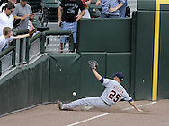 CHICAGO - JUNE 08:  Ryan Raburn #25 of the Detroit Tigers makes a sliding attempt to catch a foul ball against the Chicago White Sox on June 8, 2009 at U.S. Cellular Field in Chicago, Illinois.  The Tigers defeated the White Sox 5-4.  (Photo by Ron Vesely)