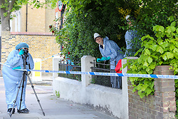 © Licensed to London News Pictures. 12/05/2019. London, UK. Search team officers on Tollington Road at the junction of Annette Road, Islington in north London as Met police launch an investigation into the death of a man who was found in a wheelie bin behind a Waitrose store shortly before 4pm on Saturday 11 May 2019.. Photo credit: Dinendra Haria/LNP