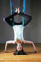 Prestonne Domareski, Director and Instructor of Gravity Yoga in Coquitlam demonstrates her skills. This is the first yoga studio in the tri-cities to offer areal yoga.