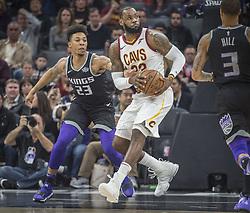 December 27, 2017 - Sacramento, CA, USA - The Sacramento Kings' Malachi Richardson, left, defends the Cleveland Cavaliers' LeBron James (23) as he goes to the basket on Wednesday, Dec. 27, 2017, at Golden 1 Center in Sacramento, Calif. (Credit Image: © Hector Amezcua/TNS via ZUMA Wire)
