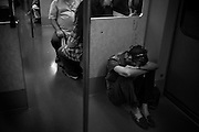 """Athens, Greece – A man sitting on the floor in the Athens metro. Greek economical crisis started in 2008. The so-called Austerity measures imposed to the country by the """"Troika"""" (European Union, European Central Bank, and International Monetary Fund) to reduce its debt, were followed by a deep recession and the worsening of life conditions for millions of people. Unemployment rate grew from 8.5% in 2008 to 25% in 2012 (source: Hellenic Statistical Authority). <br /> Bruno Simões Castanheira"""