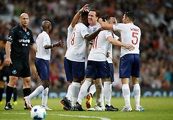 England's Darren Bent (centre left) celebrates scoring his side's first goal of the game with team mates during the UNICEF Soccer Aid match at Old Trafford, Manchester.