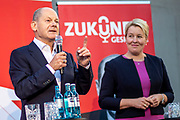 German Minister of Finance and SPD Chancellor candidate Olaf Scholz (L) delivers a speech next to SPD top candidate for the position of Berlin's Governing Mayor Franziska Giffey during an elections campaign event in Berlin, Germany, September 03, 2021. The German Federal elections are scheduled to take place on September 26, 2021.