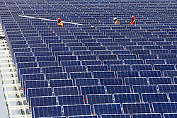 April 24, 2018 - Huaibei, China - A photovoltaic power plant is completed in Huaibei. A photovoltaic power station, also known as a solar park, is a large-scale photovoltaic system (PV system) designed for the supply of merchant power into the electricity grid. (Credit Image: © SIPA Asia via ZUMA Wire)