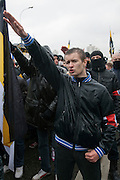 Moscow, Russia, 04/11/2010..Demonstrators from the Movement Against Illegal Immigration and other ultra-nationalist groups make fascist salutes as they march in Moscow. The demonstration, called the Russian March, was organised to mark the National Unity Day holiday, which has replaced the old holiday celebrating the Bolshevik Revolution, and which extremist nationalist groups have tried to make their own.
