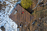 Brad Allen rests on the roof of his sugar shack while boiling maple say in to maple syrup near Green Bay, Wisconsin.