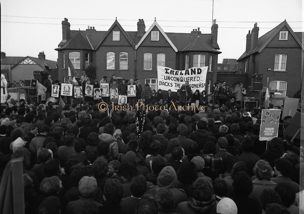 """H-Block Hunger-Strike Protest.   (M54)..1980..06.12.1980..12.06.1980..6th December 1980..In support of the prisioners on hunger strike in Northern Ireland a protest march was organised in Dublin. The march was to highlight the treatment of prisioners who wer on hunger strike and on the """"blanket"""" protest. Part of the prisioner demand was that they be treated as political prisioners and not as criminals or terrorists..Image of the platform set up on Merrion Road, Dublin. An tAthair Piaras ÓDúill is seen addressing the crowd."""