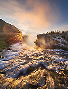 First light over Swiftcurrent Falls in Glacier National Park, Montana.