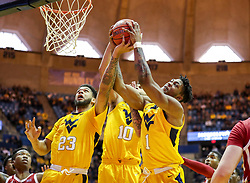 Feb 2, 2019; Morgantown, WV, USA; West Virginia Mountaineers forward Esa Ahmad (23) and West Virginia Mountaineers guard Jermaine Haley (10) and West Virginia Mountaineers forward Derek Culver (1) jump for a rebound during the second half against the Oklahoma Sooners at WVU Coliseum. Mandatory Credit: Ben Queen-USA TODAY Sports