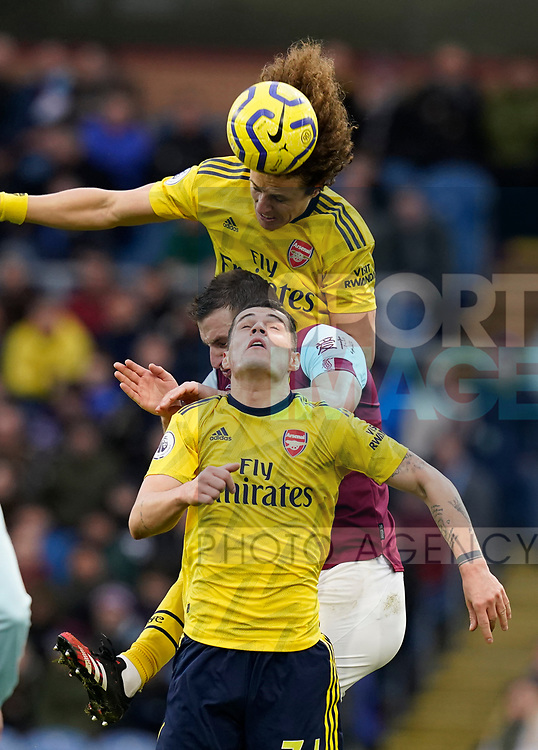 Chris Wood of Burnley mixes it up with Granit Xhaka and David Luiz of Arsenal during the Premier League match at Turf Moor, Burnley. Picture date: 2nd February 2020. Picture credit should read: Andrew Yates/Sportimage