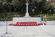 The cross of Sacrifice with Remembrance Day ceremonies at the Commonwealth War Cemetery in Hodogaya, Yokohama, Japan. Wednesday November 11th 2015