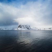 Clouds conceal summit of Olstind mountain peak, Toppøya, Moskenesøy, Lofoten Islands, Norway