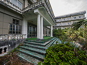 "The most beautiful abandoned looking hotel, once promoted as ""Hawaii of Japan""<br /> <br /> The abandoned Oriental Resort Hotel (Hachijo Royal Hote) Hachijojima Island, Japan Though the island was once promoted as ""Hawaii of Japan,"" the number of tourists has decreased over the years.<br /> <br /> The most beautiful abandoned looking hotel – this title goes to the Hachijo Royal Hotel, once the biggest hotel in all of Japan.<br /> <br /> The mid 1960s heralded in an era which saw Japanese tourists travelling abroad in substantial numbers for the first time. Prior 1964, the Japanese Government made it near impossible for the average Japanese to acquire a passport to travel overseas. As comparatively close destinations such as those in Asia and the Pacific were off limits during the earlier part of the decade, the tourism industry looked nearer to home to find an equivalent haven. Thankfully they didn't need to look too far with the Izu Islands sporting the subtropical volcanic island of Hachijo-jima 287 kilometres (178 miles) south of Tokyo. Short travel times by ferry and a readymade airport relinquished from Imperial Japanese Navy control meant the island could quickly scale up and handle large numbers of inbound tourists.<br /> <br /> Government attempts to promote the island as the ""Hawaii of Japan"" resonated positively and soon the island saw a rapid influx of investment and property development. The largest among these was the lavish Hachijo Royal Hotel modelled on French Baroque architecture. Along with plaster renditions of Greek statues and ornate water fountains it stood proudly as a showcase of the economic boom taking place on the mainland. At the time of its opening in 1963 it was one of the largest hotels in Japan and attracted its cliental from the ever expanding Japanese middle class. The hotel complex was even audacious enough to embellish its then company's president Eiji Yasuda with his own statue alongside his prized horse.<br /> <br /> Fast forward 30 years and cracks had plainly emerged. With ov"