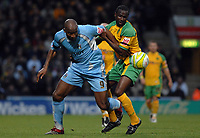 Photo: Ashley Pickering/Sportsbeat Images.<br /> Norwich City v Coventry City. Coca Cola Championship. 24/11/2007.<br /> Dele Adebola of Coventry (L) and loan signing Mo Camara of Norwich