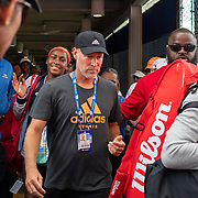 2019 US Open Tennis Tournament- Day Five.  Coco Gauff and Catherine McNally of the United States are escorted back to the players rooms by security after their victory against Julia Goerges of German and Katerina Siniakova of the Czech Republic in the Women's Doubles Round One match on a packed Court Five at the 2019 US Open Tennis Tournament at the USTA Billie Jean King National Tennis Center on August 30th, 2019 in Flushing, Queens, New York City.  (Photo by Tim Clayton/Corbis via Getty Images)