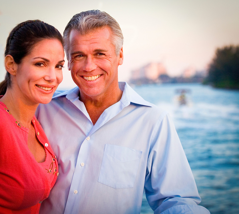 A couple on the dedicated ferry going from the Fisher Island Resort (in the background) to Miami Beach