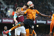 Nikica Jelavic of West Ham United is challenged by Dominic Iorfa (18) of Wolverhampton Wanderers and Danny Batth of Wolverhampton Wanderers (c). The Emirates FA cup, 3rd round match, West Ham Utd v Wolverhampton Wanderers at the Boleyn Ground, Upton Park  in London on Saturday 9th January 2016.<br /> pic by John Patrick Fletcher, Andrew Orchard sports photography.