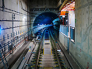 "27 DECEMBER 2015 - SINGAPORE, SINGAPORE:  A train goes through the subway tunnels on the newly expanded Downtown Line in Singapore. Singapore opened the extension of the Downtown Line on its subway system Sunday. The extension is a part of Singapore's plans to make the city-state a ""car lite"" metropolis with plans to double the current subway to more than 360 kilometers of track by 2030. The government plans to have 80% of homes within a 10 minute walk of a subway station.   PHOTO BY JACK KURTZ"