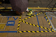 Foreign media tape markings for their TV broadcasts outside St Mary's Hospital, Paddington London, where media and royalists await news of Kate, Duchess of Cambridge's impending labour and birth to a baby boy. Some have been camping out for up to two weeks during a UK heatwave, having bagged the best locations where the heir to the British throne will eventually be shown to the waiting world.