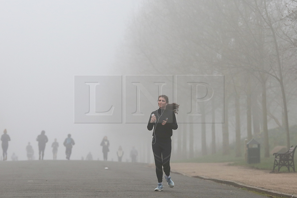 © Licensed to London News Pictures. 03/03/2021. London, UK. A runner in Finsbury Park, north London on a foggy morning. The Met Office has issued a yellow weather warning for fog in some parts of south east England with low visibility. Photo credit: Dinendra Haria/LNP