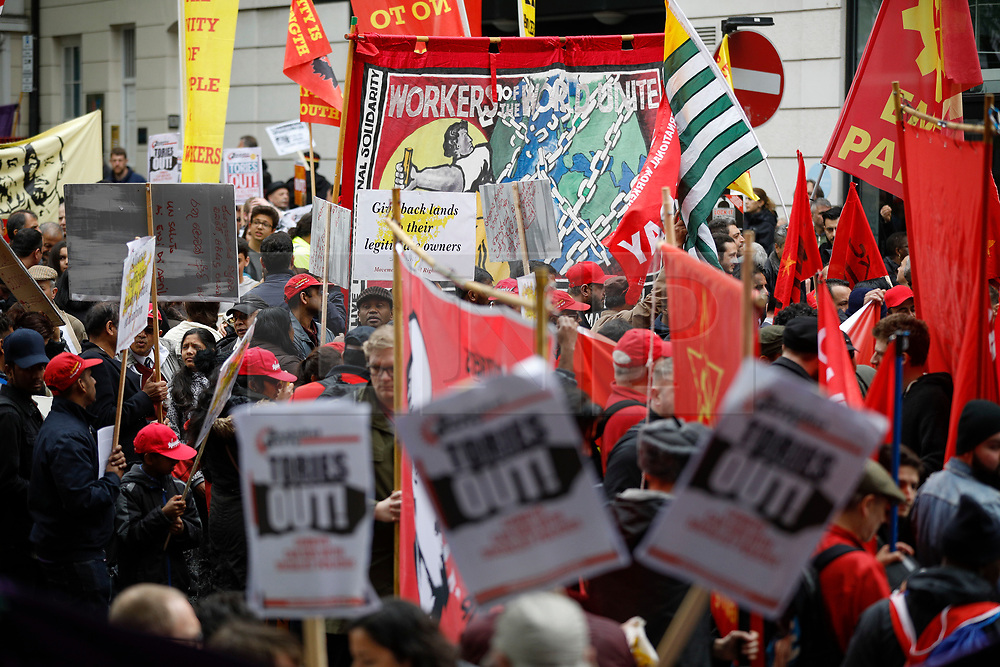 © Licensed to London News Pictures.01/05/2017.London, UK. A far left banner and communist flags, as Workers and activists take part in a march from Clerkenwell Green to Trafalgar Square in London on May,  May 1, 2017.Photo credit: Tom Nicholson/LNP