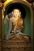 A buddha statue in the Shwedagon pagoda, the most sacred pagoda in the country, in the capital of Yangon (Rangoon), Myanmar