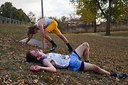 High school runners collapse after completing the Metro Conference Cross Country Meet on Thursday, October 15, 2020, at McHardy Park in Brandon.