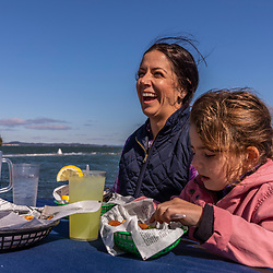 A family has lunch in Lubec, Maine. Lubec Narrows.