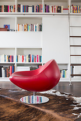Chair in livingroom infront of book shelf