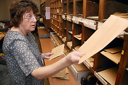 Clerical Officer distributing mail into pigeon hole system in the external post room to be forwarded to GPs; and  other hospitals,