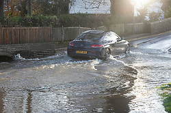 ©Licensed to London News Pictures 23/12/2019. <br /> Eynsford ,UK. A car driving in flood water. The River Darent water levels have continued to rise this morning causing flooding to parts of Eynsford Village in Kent. Photo credit: Grant Falvey/LNP