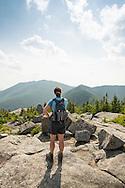 HIker on the summit of Grace Peak
