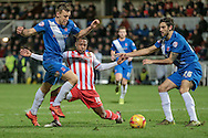 Hartlepool defenders get the ball of Aaron O'Connor (Stevenage) during the Sky Bet League 2 match between Hartlepool United and Stevenage at Victoria Park, Hartlepool, England on 9 February 2016. Photo by Mark P Doherty.