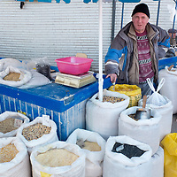 TIMISOARA, ROMANIA - APRIL 21:  A market seller of bird food poses in front of his  stall at the daily market on April 21, 2013 in Timisoara, Romania.  Romania has abandoned a target deadline of 2015 to switch to the single European currency and will now submit to the European Commission a programme on progress towards the adoption of the Euro, which for the first time will not have a target date. (Photo by Marco Secchi/Getty Images)