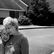 """Bob's wife and daughter embrace after deciding to place Bob in an assisted-living facility, seen behind them. He had become increasingly agitated and had violent spells towards his wife...ltqmb     """"Hard decision"""""""