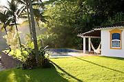 Private home in Parati Brazil. The guest house with morning steam rising from the pool.