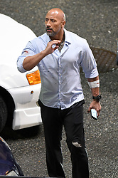 The Rock breaks free from Police on set of Skyscraper in Vancouver, Canada. Dwayne 'The Rock' Johnson was seen filming scenes in downtown Vancouver of his latest film Skyscraper 2018. The scene involved the actor looking at a GPS location on his phone outside a Stadium, there is then a huge bang and gunfire before he is arrested by police. DJ breaks free before running through the traffic with his arm bandaged and wearing a blood splattered shirt. The Rock has been filming scene all month with co-star Neve Campbell, the film is set for release next year. 18 Oct 2017 Pictured: Dwayne Johnson, The Rock. Photo credit: Atlantic Images/MEGA TheMegaAgency.com +1 888 505 6342