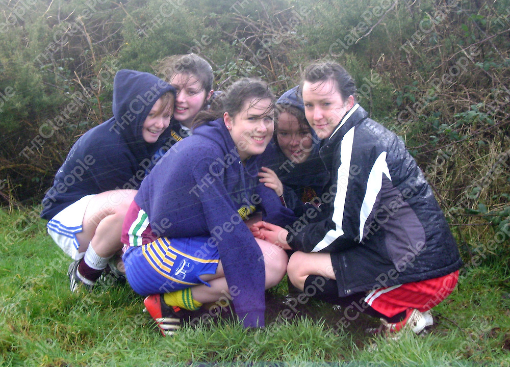 Students from Scoli Mhuire Ennistymon take shelter from a shower during the Clare secondary schools cross country competition in Mullagh.