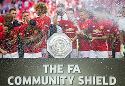 Players celebrate with the Community Shield after Manchester United win the match 1-2 - Rogan Thomson/JMP - 07/08/2016 - FOOTBALL - Wembley Stadium - London, England - Leicester City v Manchester United - The FA Community Shield.