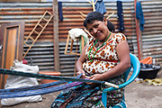 A Guatemalan woman waeving making textiles in the traditional way, in San Juan La Laguna - one of the villages on the banks of Lake Atitlan. It is smaller than many of the other towns and with many pess toruists, which has allowed it to preserve much of its traditional culture, which is making textiles with natural dyes. Lake Atitlan is seen as the most important single tourist attraction in Guatemala; and is Central Americas deepest lake. There are many villages on the banks of the lake; each with different identity and culture; the majority of the population in the region identify as indigenous Maya and many still wear traditional dress and speak Maya languages.